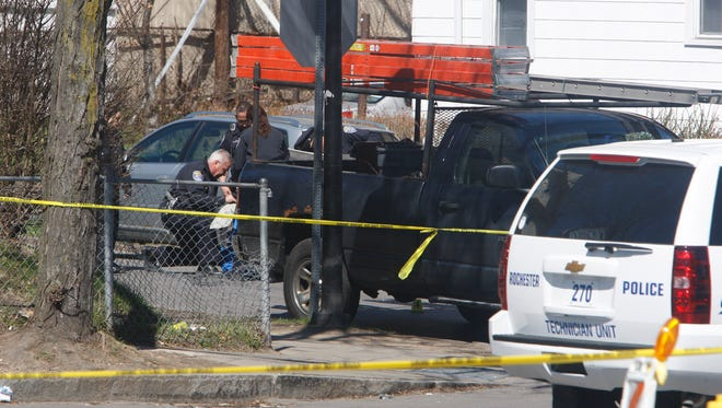 Rochester police investigate a shooting at the corner of Hudson Avenue and Fairbanks Street about 8:30 a.m. on April 25, 2015 which left a man dead.