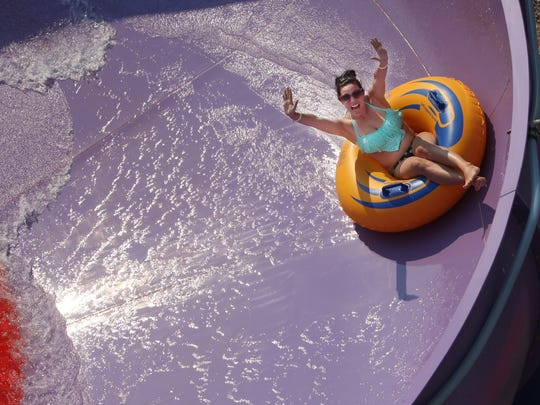 Kayla Kyle spins around 'Tornado Alley' at Wild Water West on Sunday, June 28, 2015. The new 55-foot tube slide attraction opened this season.