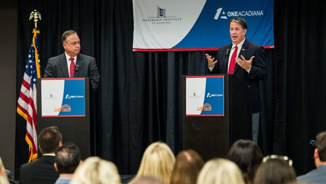 City-Parish President candidates Dee Stanley and Joel Robideaux, from left, debate on stage at the Cecil Picard Center in Lafayette, La., Wednesday, Oct. 7, 2015. The debate was hosted by One Acadiana and Leadership Institute of Acadiana.