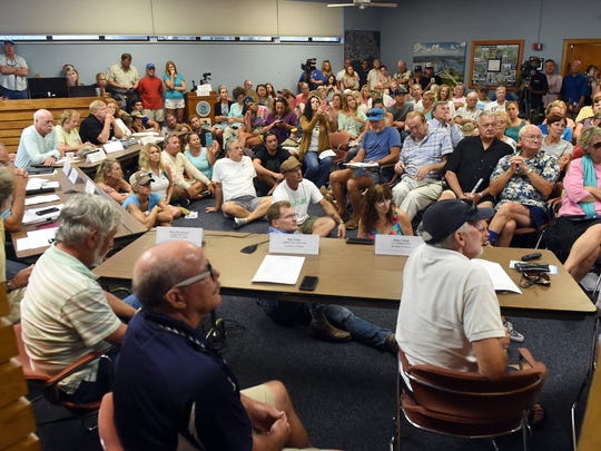 An overflow crowd gathered to discuss the Lake Okeechobee discharges and the pollution of local waterways during the Rivers Coalition meeting June 29, 2016 in the City of Stuart Commission Chambers at Stuart City Hall.