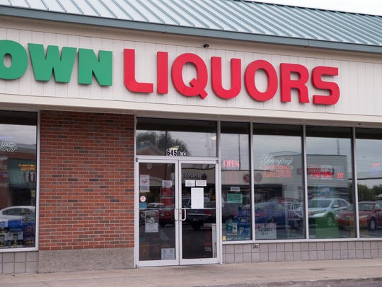The building front of Crown Liquor, 645 W 11th St,