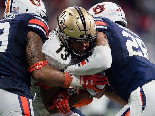 Auburn defensive back Tray Matthews (28) and Auburn
