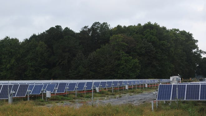 A large group of solar panels sit on a solar farm site on Neal Parker Road near Oak Hall, Va. on Wednesday, Sept. 28, 2016.