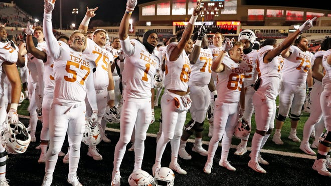 """Texas football players sing """"The Eyes of Texas"""" after a game at Texas Tech in 2018."""