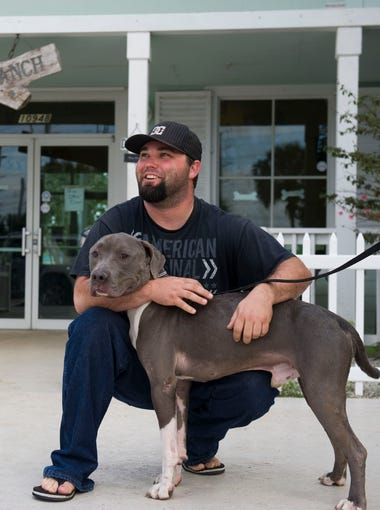"After searching around at shelters and meeting dozens of other dogs, Marine Lance Cpl. David Merrill holds his new canine, Recon, after adopting him Feb. 5, 2016 from Big Dog Ranch Rescue in Loxahatchee. Recon, originally called Arthur, will be trained as Merrill's service dog, helping to calm his anxiety and post-traumatic stress disorder diagnosis stemming from his tour of duty in Iraq in 2009. ""I've never had that connection with animals so for me to find that, have that kind of bind... he's a definite for me,"" Merrill said. ""I told them this is the dog. For some reason I knew right off the bat, this is him."""