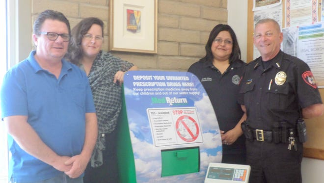 From left, are Youth Substance Abuse Prevention Coalition Coordinator Michael McGee and founding Coalition member Kendra Milligan, present Bayard Dispatcher Judy Diaz and Bayard Chief of Police Willy Kerin with the new MedReturn kiosk so residents can safely dispose of over-the-counter and prescription drugs. Also, YSAPC donated was an electronic platform scale to weigh the disposed of medications before being turned over to the DEA for destruction.