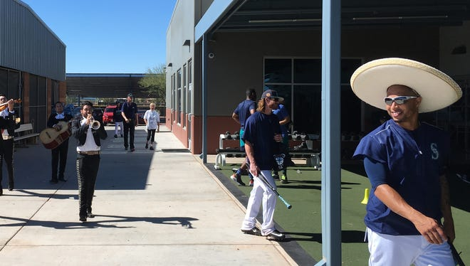 A mariachi band plays for the Mariners' Leonys Martin, far right, in honor of his 29th birthday Monday as he arrives at the team's spring training clubhouse in Peoria, Ariz.