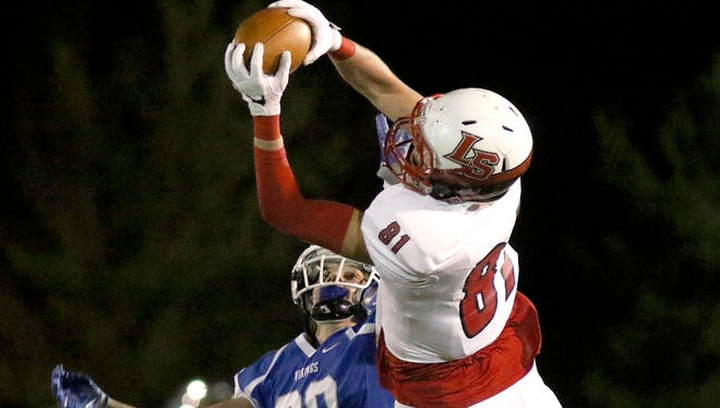 La Salle's John Whyle makes a catch during the Lancers' win over Miamisburg, Friday, Nov. 18, 2016.