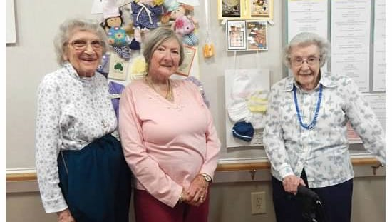 Left to right, Charlotte Young, Wenona Spencer, Lucille Tompkins are three members of a knitting group that have made more than 800 hats for newborn babies at Cayuga Medical Center.