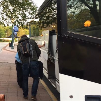 Passengers on Friday, October 2, 2015, board a bus