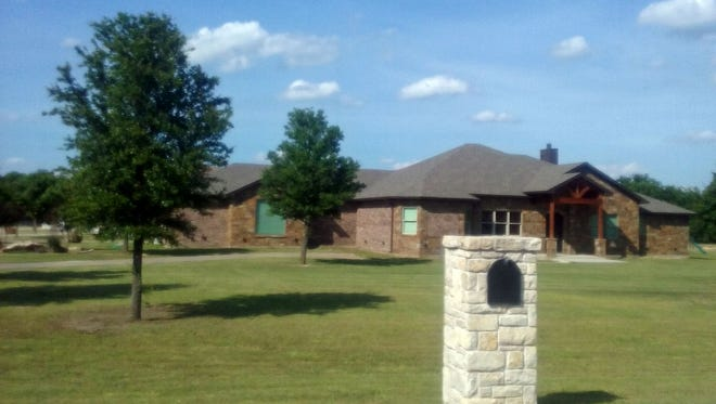 The homeowners association  at the Hills of Bear Creek has filed a lawsuit against the owners of this home, alleging they are operating a swingers club.