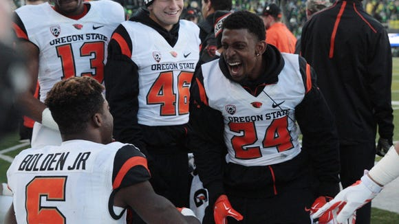 Nov 27, 2015; Eugene, OR, USA; Oregon State Beavers running back Storm Woods (24) celebrates with wide receiver Victor Bolden (6) after scoring against the Oregon Ducks at Autzen Stadium. Mandatory Credit: Scott Olmos-USA TODAY Sports