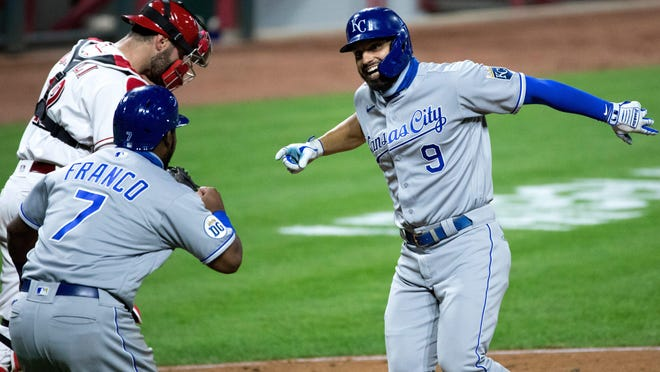 Kansas City Royals first baseman Ryan McBroom (9) celebrates with Kansas City Royals third baseman Maikel Franco (7) after hitting a two-run home run in the eighth inning of Tuesday's game against the Cincinnati Reds. The Royals rallied from a 5-1 deficit and tied the game 5-5 on the blast but fell 6-5 in 10 innings, snapping their four-game winning streak. [Albert Cesare/USA TODAY]Cincinnati Reds Kansas City Royals 34