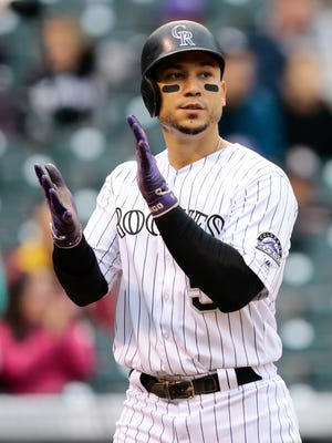 Carlos Gonzalez posted a .262/.339/.423 slash and 14 home runs last season with the Rockies.