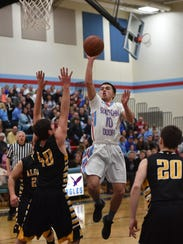 Southern Door's Nick LeCaptain drives the lane against