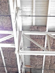Dense insulation allows portions of the beams to remain exposed.