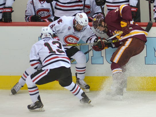 St. Cloud State's Joey Benik (9) and Ethan Prow (12)