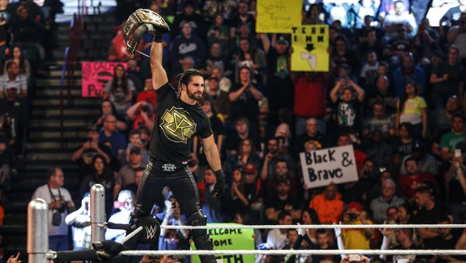 WWE champion and Davenport native Seth Rollins climbs into the ring at the Quad Cities' iWireless Center on April 28.