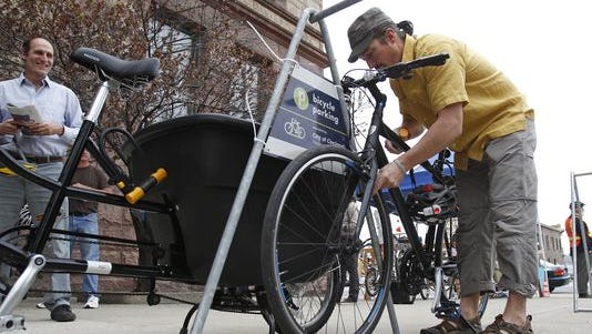 Chris Griffith of Over-the-Rhine locked up his bike as he arrived at City Hall Monday for a meeting of the Neighborhoods Committee about the fate of Central Parkway bike lane.