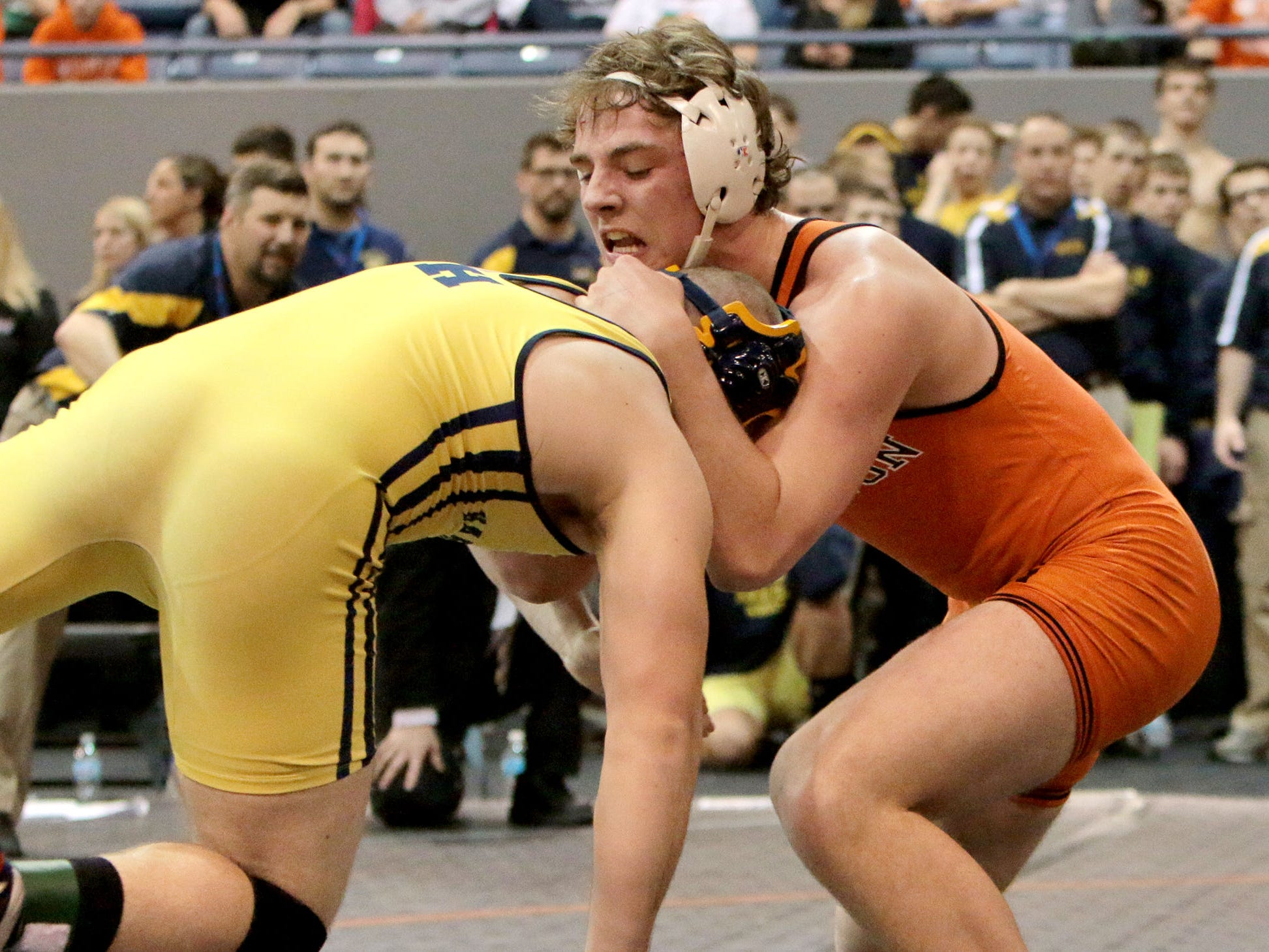 Brighton's Eric Conquest defeats Hartland's Aaron Laird in their match at 215 pounds.