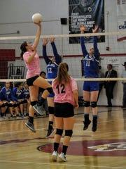 Aubrey Brandenberger powers the ball over the net for