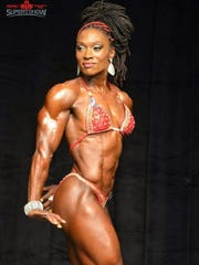 Former University of Detroit Mercy soccer standout Nathalee Thompson, now a professional body builder, is shown competing in Toronto in 2015.