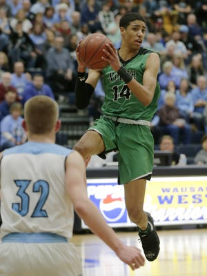 Oshkosh North's Tyrese Haliburton passes during the second half against Eau Claire North in a WIAA sectional boys basketball game.