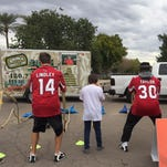 Arizona Cardinals Ryan Lindley, left and Stepfan Taylor, right, joined hundreds of kids at a Tempe museum for a diversity program on Jan. 26, 2015.