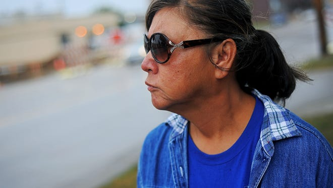 Donna Rose Peniska, who says she has been living on Sioux Falls' streets for about five years, walks along East Eighth Street Wednesday,