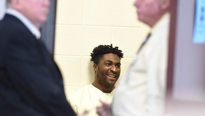 Cory Batey waits in the back for a hearing in Judge Monte Watkins' courtroom in the A. A. Birch building Aug. 3, 2016.