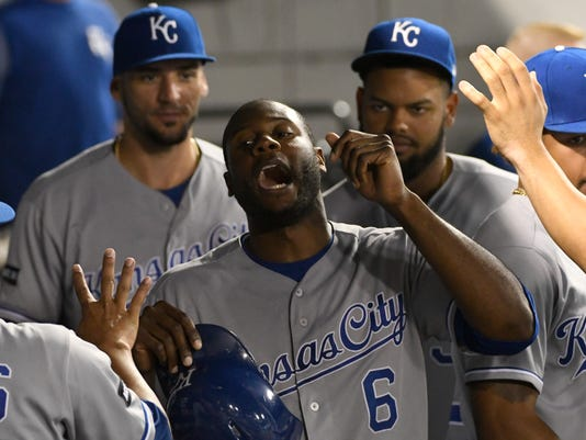Kansas City Royals' Lorenzo Cain (6) is greeted by his teammates after scoring against the Chicago White Sox during the third inning of a baseball game, Friday, Sept. 22, 2017, in Chicago. (AP Photo/David Banks)