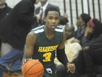 Senior guard Trevon Dixon pushes the ball up the floor for Harrison.