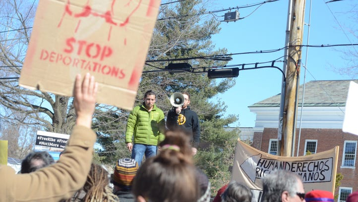 A rally against arrests of Vermont dairy workers by Immigration and Customs Enforcement ended at the Federal Court House in Burlington on March 18, 2017.