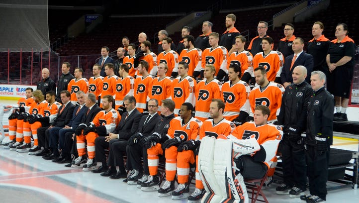 General manager Ron Hextall,  front, center, has more responsibility than ever with the club.