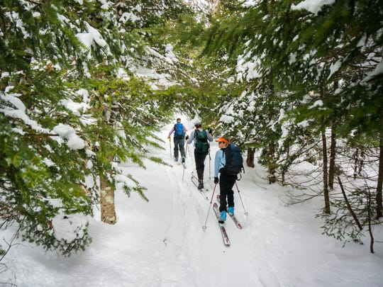 The Catamount Trail staff skis Section 22 of the Catamount Trail between Bolton Valley and Nebraska Valley Road. Skiers front to back: Emily Licht, Matt Larson, Amy Kelsey