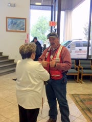 "Ruidoso Village Manager Debi Lee talks to American Red Cross community volunteer leader Robert Barber before issuing a statement about the ""crash"" to the media as part of the emergency exercise at the municipal airport."
