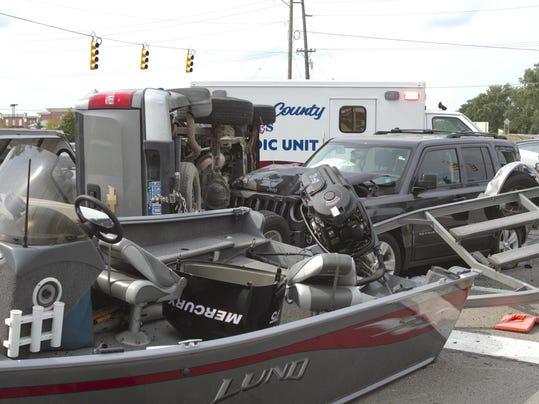 Cars boat trailer crash