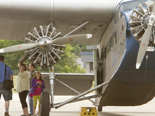 Residents Ride In Luxury On Historic Ford Tri Motor