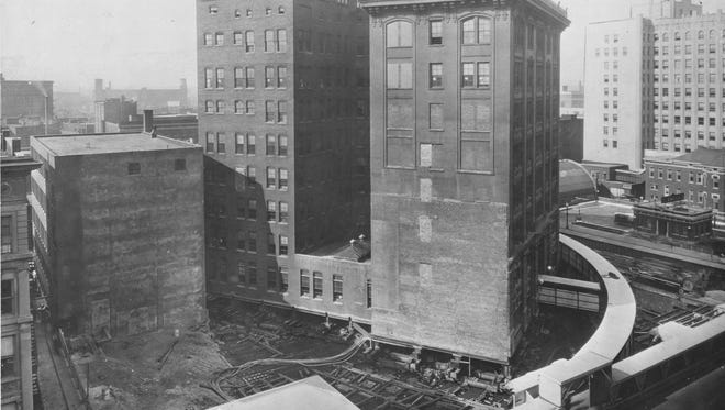 The eight-story, 11,000-ton Indiana Bell building rotation in 1930. The curved protected walkway is to the right.