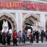 The Casino Control Commission on Wednesday approved billionaire investor Carl Icahn to own the Trump Taj Mahal Casino Resort. In this photo taken last fall, union members picket outside the Trump Taj Mahal Casino Resort in Atlantic City to protest the elimination of their health insurance and pension plan as part of the casino's bankruptcy filing.