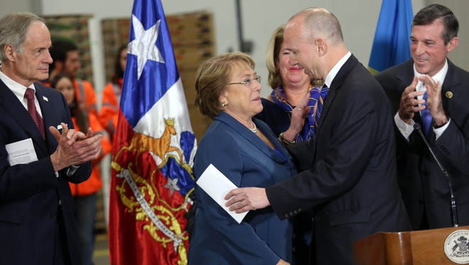 Gov. Jack Markell embraces Chilean President Michelle Bachelet when she visited the Port of Wilmington on Jan. 20, 2015. Markell recently visited the South American country to maintain strong trade ties.