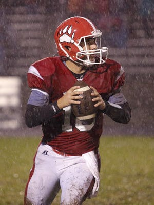 Laingsburg quarterback Nick Putnam is one of several returning starters for the Wolfpack, who are coming off back-to-back eight-win seasons.