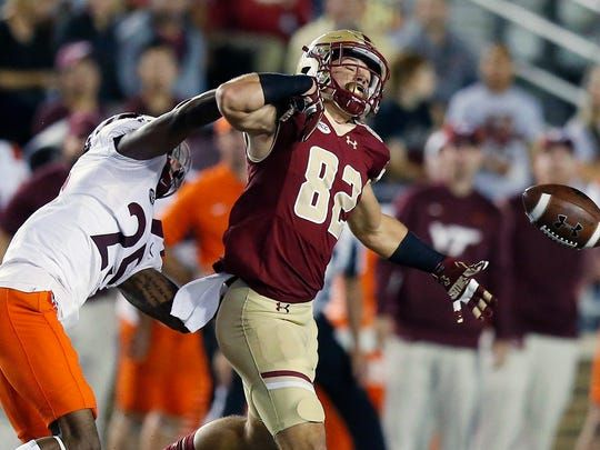 Virginia Tech's Greg Stroman, (25) breaks up the pass intended for Boston College's Nolan Borgersen (82) during the first half of an NCAA college football game in Boston, Saturday, Oct. 7, 2017. (AP Photo/Michael Dwyer)