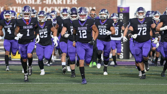 The Mount Union football team takes the field prior to a 2019 playoff game against Hanover.