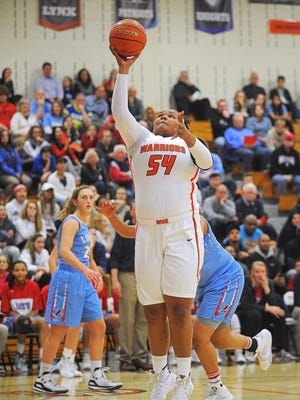 Washington's Sydney Arrington (54) goes up for a shot during a game against Lincoln Tuesday, Jan. 5, 2016, at Washington High School in Sioux Falls.