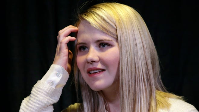 FILE - In this April 24, 2015, file photo, kidnapping survivor Elizabeth Smart looks on during a news conference in Sandy, Utah.