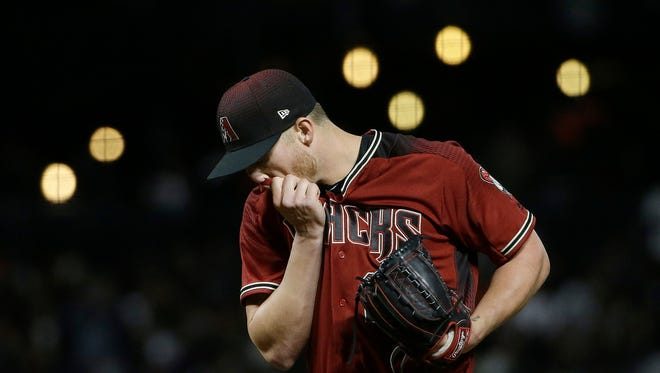 Arizona Diamondbacks pitcher Shelby Miller reacts after walking San Francisco Giants' Brandon Belt during the fifth inning of a baseball game in San Francisco, Wednesday, April 12, 2017.