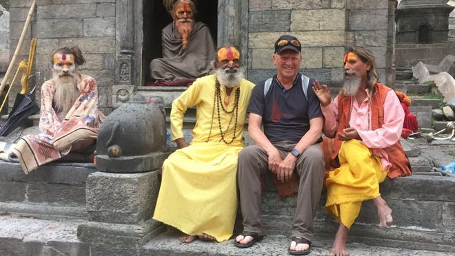Gary Ervin poses with Sadhus, or Hindu holy men, at a Hindu temple in Kathmandu, before leaving on the excursion to climb Mount Everest in 2016.