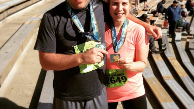 Special to the News Sentinel Ryne Goodrich and Amy Goodrich show off their medals after finishing the half marathon at the Covenant Health Knoxville Marathon in 2014.
