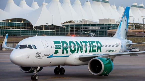 A Frontier Airbus A320neo pulls into a gate at Denver